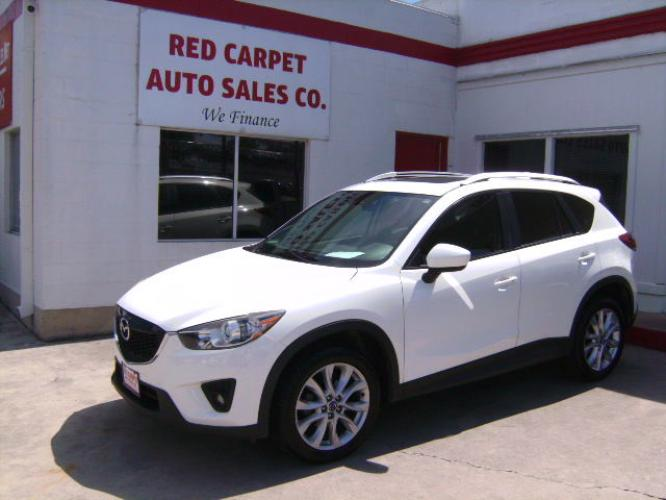 2015 WHITE Mazda CX-5 Grand Touring (JM3KE2DY8F0) with an 2.5L L4 DOHC 16V engine, 6-Speed Automatic transmission, located at 503 West Court, Seguin, TX, 78155, (830) 379-3373, 29.568621, -97.969803 - Photo #0